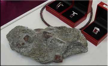 Garnet jewelry and garnet bearing rock